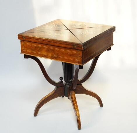 A late Victorian rosewood and marquetry envelope folding card table