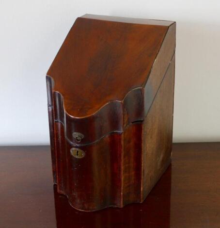 A George III mahogany serpentine knife box