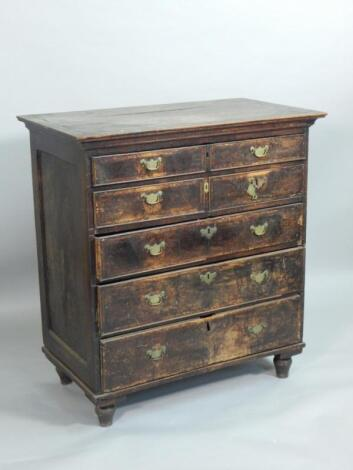 A mid 18thC walnut and oak chest of drawers