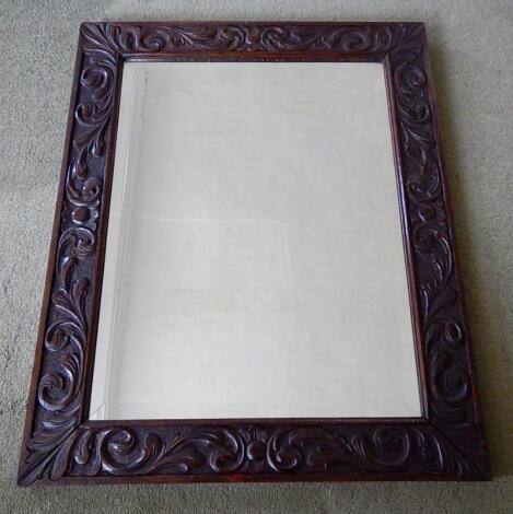 A bevelled rectangular wall mirror