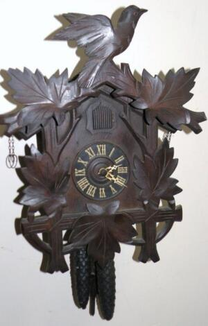 An early 20thC German Black Forest cuckoo clock.