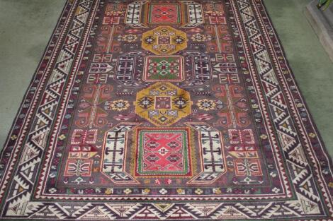 A Middle Eastern bordered rug