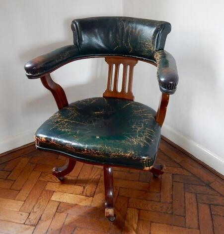 An early 20thC mahogany swivel chair