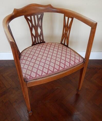 An Edwardian inlaid mahogany open armed tub chair