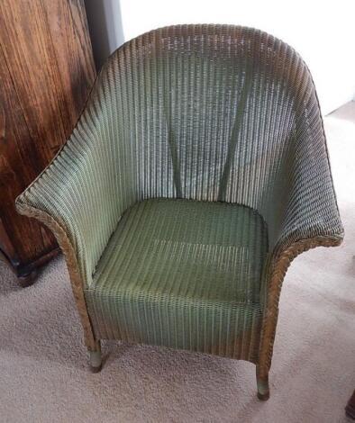 A Lloyd Loom tub chair by W. Lusty and Sons Limited