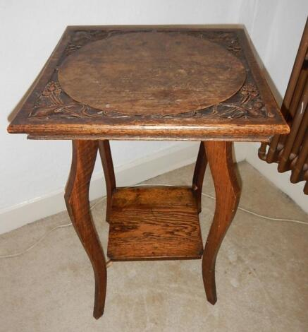 An Edwardian oak square occasional table