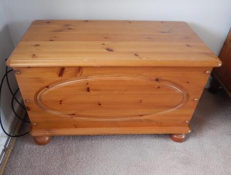 A modern pine blanket box