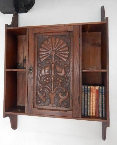 An Edwardian carved oak wall hanging cabinet