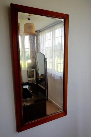 A bevelled rectangular mirror