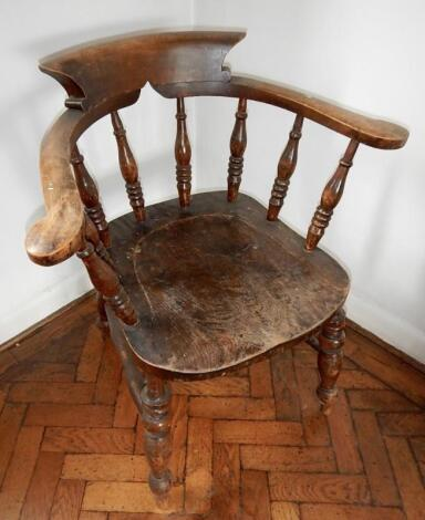 A 19thC elm and beech smokers bow chair