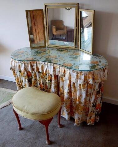 A kidney shaped dressing table