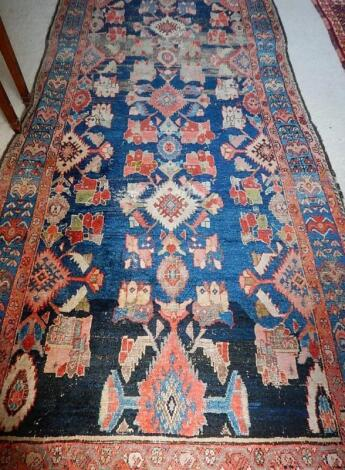 A 19thC Middle Eastern bordered rug