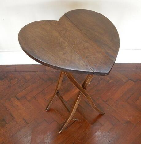 A stained beech heart shaped coaching style folding table.