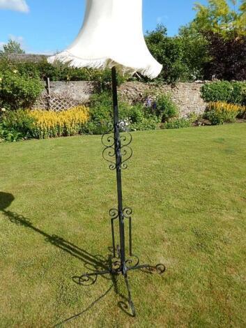 A wrought iron standard lamp