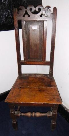 A 18thC oak hall chair