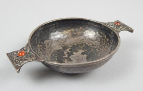 An Edwardian hammered silver Arts and Crafts style quaich by Sybil Dunlop