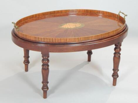 A late 19thC Sheraton Revival oval mahogany and amboyna tea tray