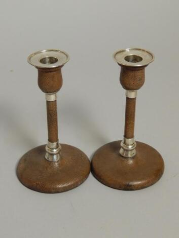 A pair of Victorian silver and brown snakeskin leather candlesticks