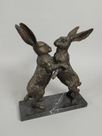 20thC British School. A pair of hares fighting