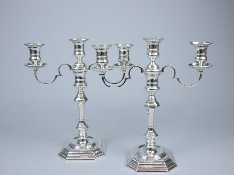 A pair of silver three branch candelabra