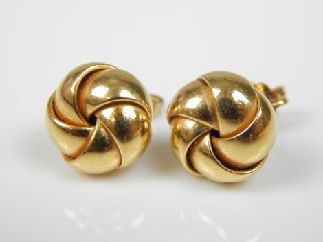 A pair of 18ct gold knot earrings