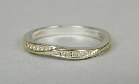 An 18ct white gold (import) diamond set half hoop eternity ring