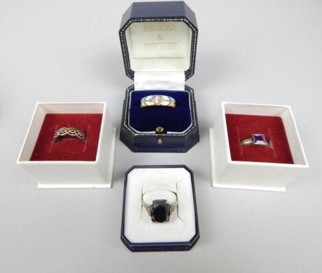 Four dress rings