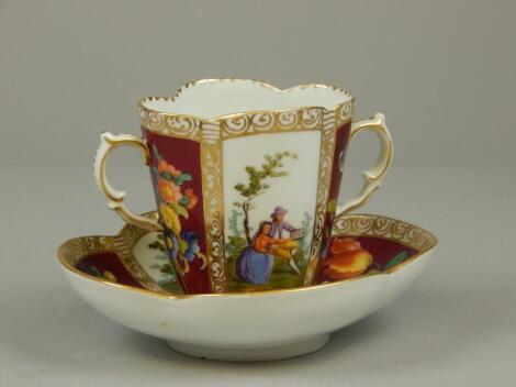 An early 20thC Dresden porcelain two handled cabinet cup and saucer
