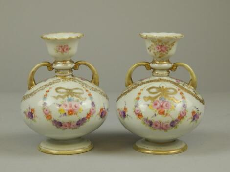 A pair of Continental porcelain two handled vases