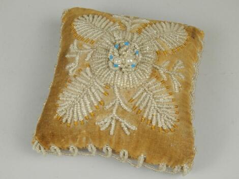 A Victorian square beadwork cushion