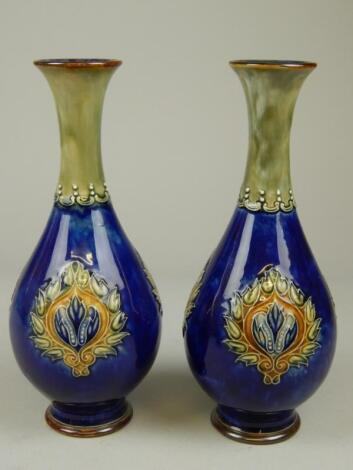 A pair of Royal Doulton stoneware bottle shaped vases
