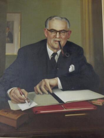 John R Townsend (1930-2014). Portrait of a gentleman sitting at his desk