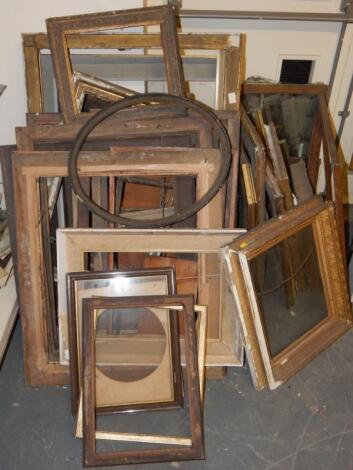 A large quantity of picture frames and mirrors.