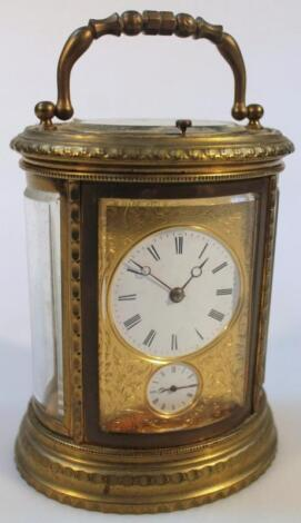 A 19thC French oval engraved brass carriage clock
