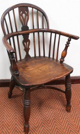 A 19thC Nottinghamshire yew wood and elm low back Windsor chair