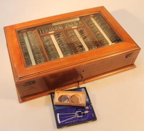 An early 20thC mahogany opticians tester lens set