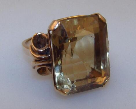 A ladies heavy claw set citrine ring