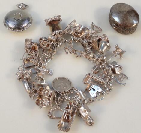 A 20thC charm bracelet