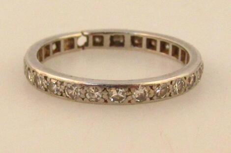 A ladies white metal eternity ring