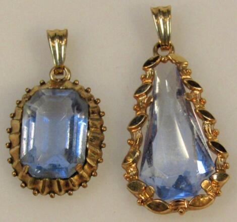 Two similar pendants