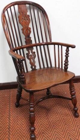 A good 19thC yew wood and elm high back Windsor chair