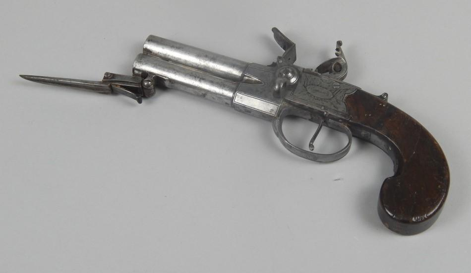 An early 19thC double barreled flintlock pistol - Price