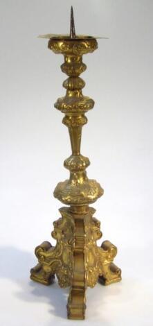 A gilt metal church altar stick