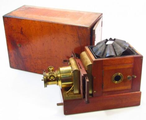 A late 19thC mahogany cased New Pamphengos magic lantern projector with W C Hughes patent