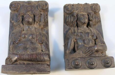 A near matching pair of 18thC carved oak panel blocks