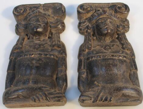 A pair of heavily carved hardwood figures