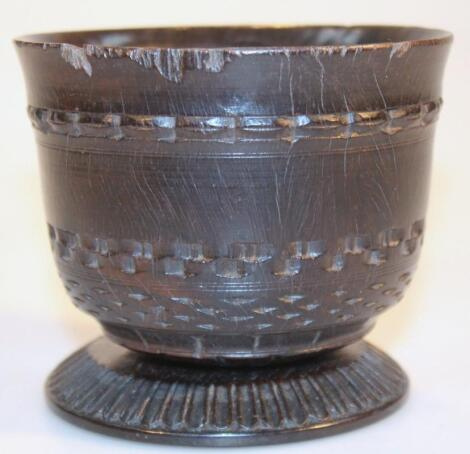 An early 19thC heavily carved bog oak cup