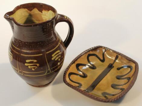 A 20thC Winchombe slip ware pottery jug