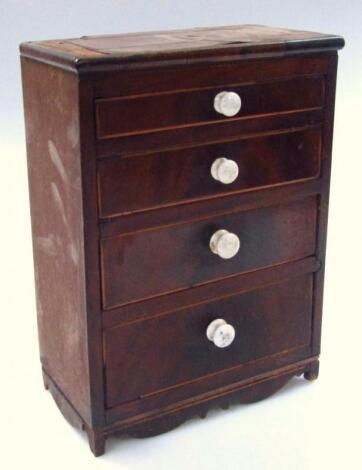 An early 19thC mahogany miniature tradesman piece chest