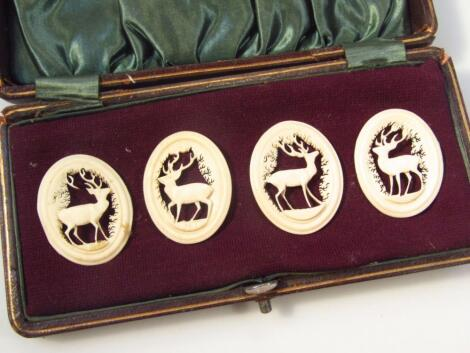 A matched set of four late 19thC carved bone ovals